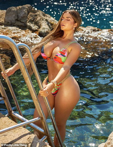 Hot: The model, 26, showcased her August cutout for the online retailer and looked amazing as she slipped into a series of stunning bikinis that left little to the imagination