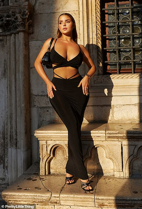 Lovely: She was dazzled by a sophisticated black design featuring a low neckline and an open front section