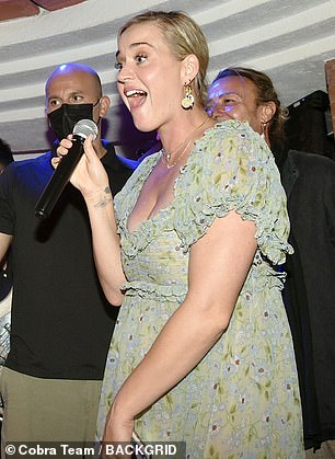 Looking good! Katy looked effortlessly stylish in the pastel-shaded dress with a frilled neckline