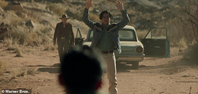 Guns:The trailer winds down with a shot of two cops pointing their guns at Rafo with Mike approaching
