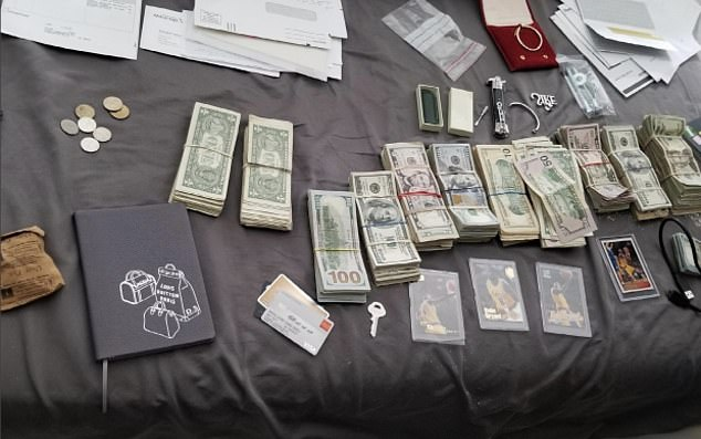 Following his arrest, police officers raided his home and seized approximated $250,000 worth of cash and goods, some of which could be seen here