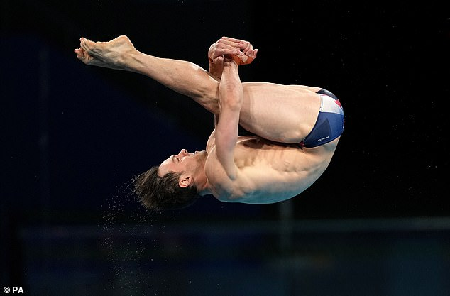 Tom Daley competing at Tokyo on Friday. He won a gold medal in the men's 10m synchronised diving for Team GB