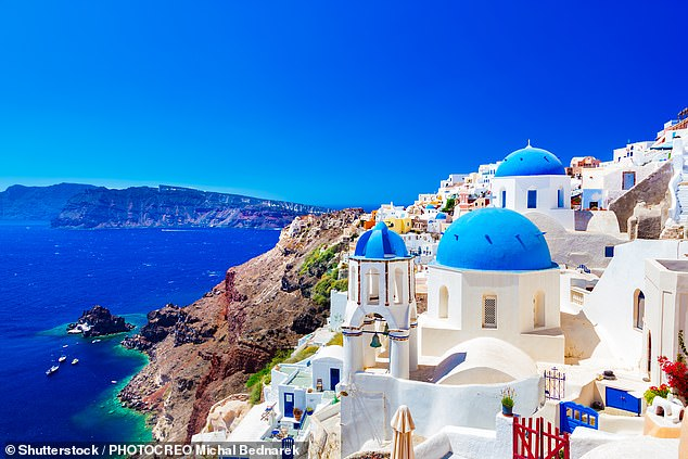 Greece has now overtaken Spain as the most popular summer 2021 destination, according to an independent travel firm. Above is the picturesque town of Oia on the island of Santorini