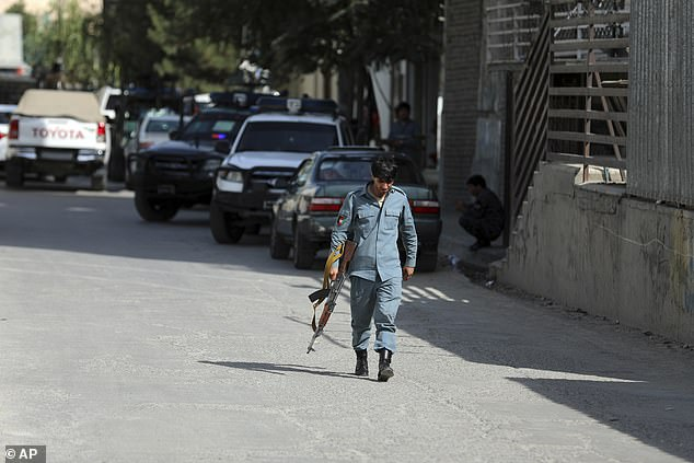 An official in the federal interior ministry said 'the savage terrorists killed' Menapal during Friday prayers. Above, Afghan security personnel arrives at the area