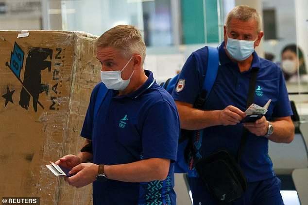 The pair were pictured at Tokyo's Narita airport boarding a flight back home, a day after they were stripped of accreditation and kicked out of Athlete's Village