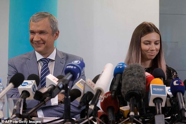 The 24-year-old gave a press conference in Warsaw Thursday alongside Belarus's exiled culture minister (left), urging other people to speak out against the regime