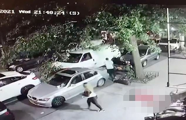 Footage shows the assassin, her purse slung over her shoulder, turn and casually walk to an SUV as her victim lays dead on the sidewalk.