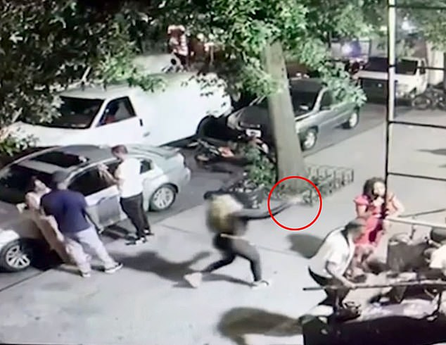 Shocking video shows the female assassin raising a gun to a woman on a Brooklyn sidewalk and shooting her dead. The victim, named by police as Delia Johnson, 42, was speaking to a group on a stoop in Crown Heights, Brooklyn, when she was shot in the head.