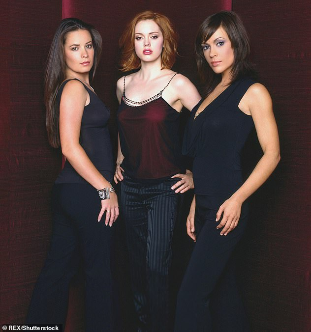 Bad blood: McGowan claimed that Milano 'threw a fit' on the set of Charmed and acted like a diva; publicity still from Charmed with Holly Marie Combs (L)