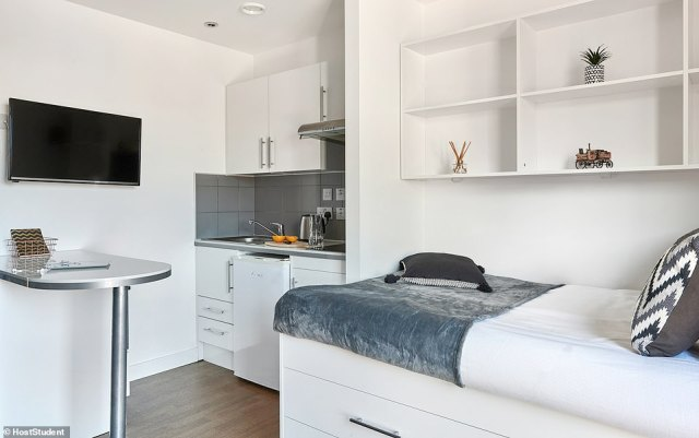 Pictured is one of the rooms atHope Street Apartments, with its 'gleaming white' interiors and neat kitchenette