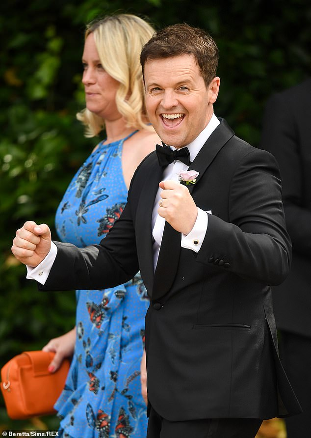 Glee: Declan Donnelly put on an animated display while exiting the church at Ant McPartlin's wedding to Anne-Marie Corbett on Saturday in Hampshire