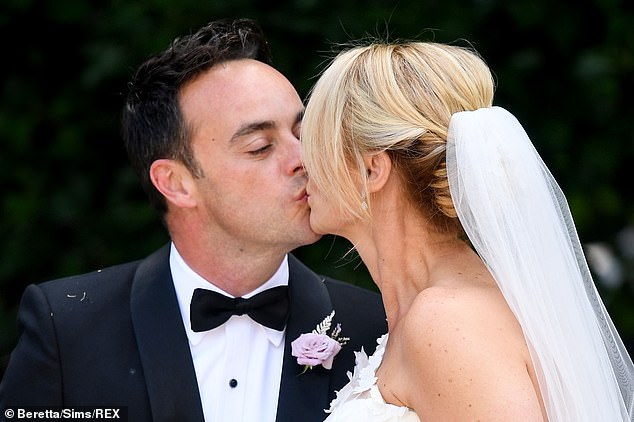 Sweet: Ant and wife Anne-Marie shared a kiss as they stepped out of the church after saying their vows to each other in front of 100 guests