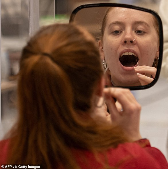 If you are suffering Covid symptoms and get a negative result from a DIY test, I'd recommend you get another one done at a walk-in centre. (File image)