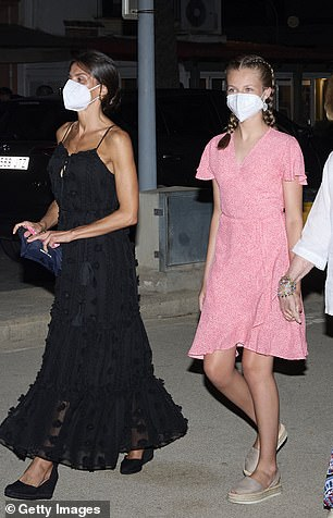 Queen Letizia is pictured leaving the restaurant with Princess Leonor last night