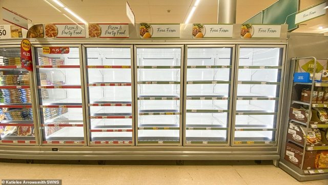 Empty supermarket shelves have been pictured across the country in recent weeks (pictured: Morrisons in Edinburgh)