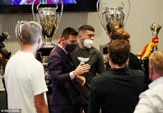 Messi is consoled by Jordi Alba and Antoine Griezmann following Sunday's press conference