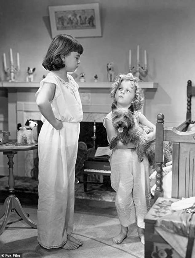 'Natural clown': The Atlanta-born, Hollywood-raised actress (L) got her big break portraying the bratty Joy Smythe opposite Shirley Temple's (R) angelic orphan in David Butler's 1934 film Bright Eyes