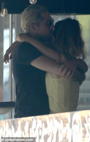 Sweet: Lily reached up while Michael held her in close to him
