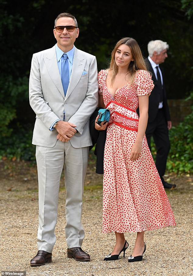 Reunited: David turned heads when he showed up to the service with his ex Keeley Hazell, who it appears he was on holiday with in Italy in the weeks before the wedding