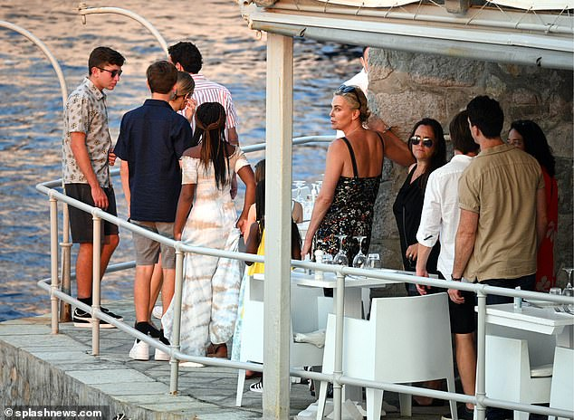 Chatting away: The group enjoyed a catch up as they looked out over the water at the eatery