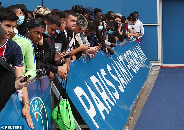 Fans were determined to be on the front row to get a glimpse of Messi when he arrives at PSG