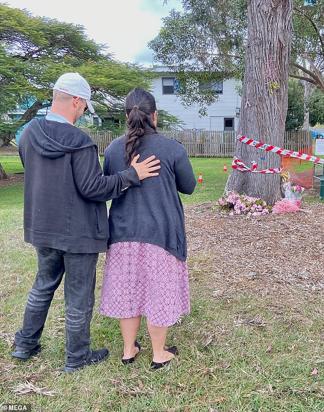 A couple who were in the park and witnessed the tragedy paid their respects as floral tributes to the five-month-old baby grew
