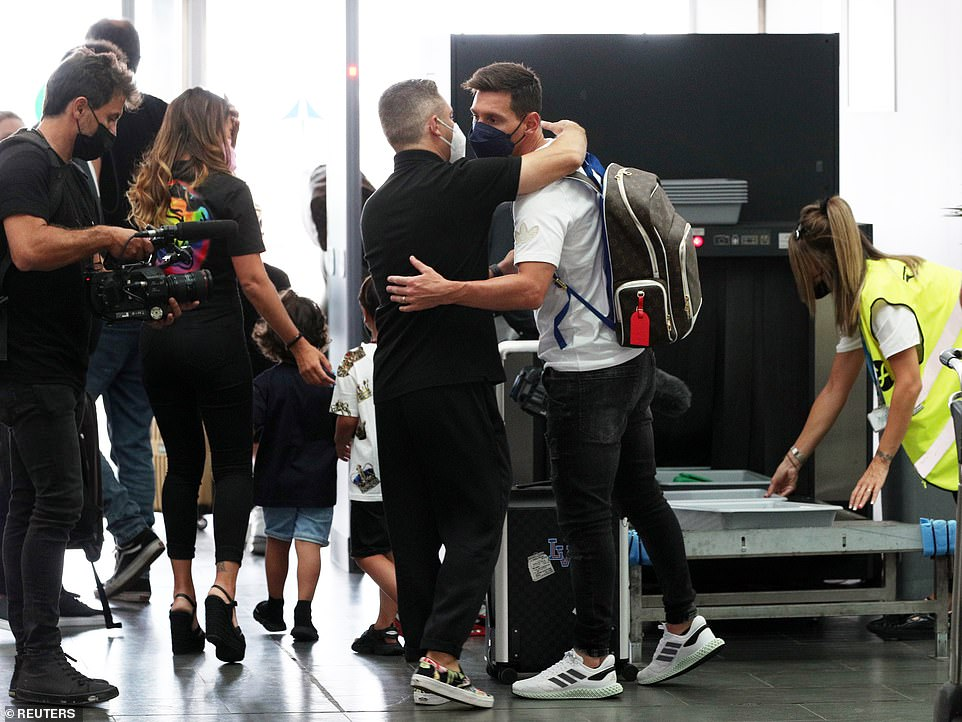 Messi shared a hug prior to going through airport security as he said his final goodbyes before jetting off to sign his PSG deal
