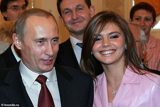 Alina Kabaeva and Vladimir Putin at an event in Kremlin in the early 2000s. It's rumoured that she has given birth to twins