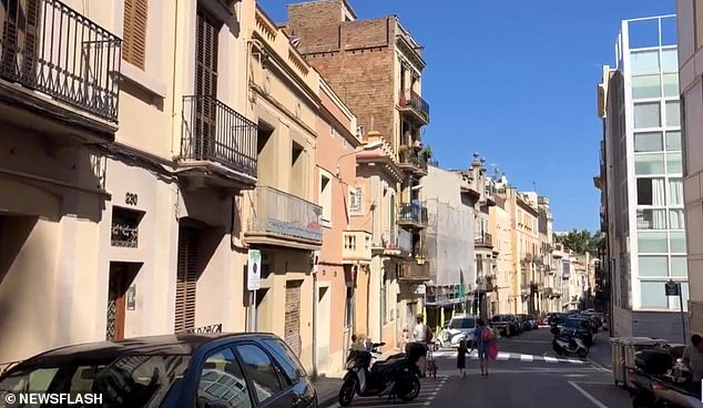 A Dutch tourist choked to death after swallowing his car keys while in Spain because locals in a shopping centre inSarria-Sant Gervasi (pictured) could not understand him as he begged for help
