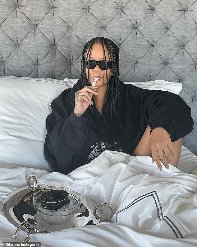 Lap of luxury! On Tuesday, she posted a joking photo of herself in bed with a massive tin of caviar on ice to celebrate that astounding financial landmark