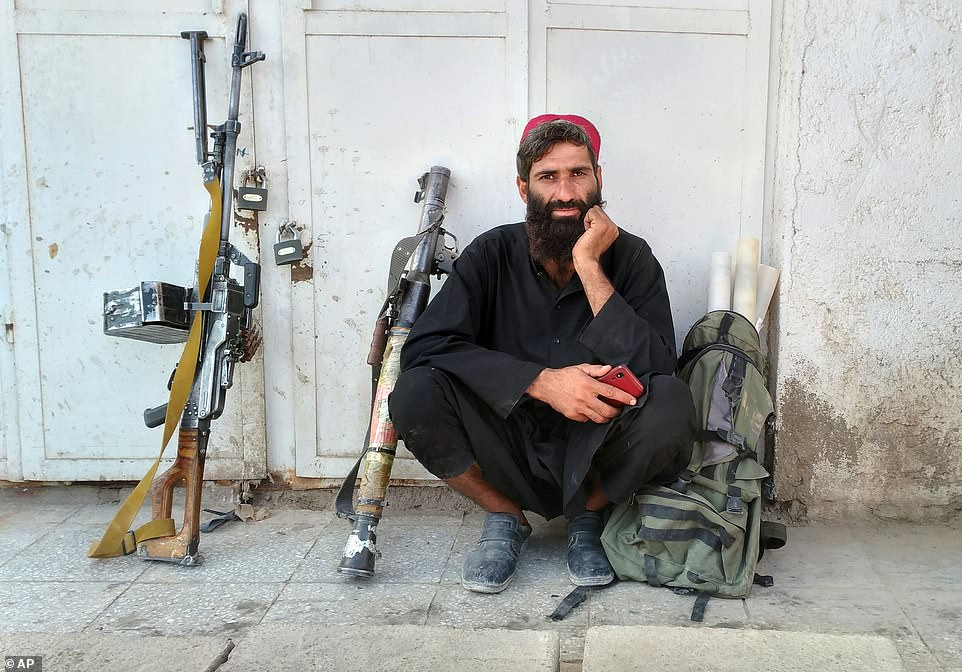 A Takiban fighter poses with heavy weapons in the city ofFarah, in western Afghanistan, which was captured by Islamist fighters on Tuesday afternoon