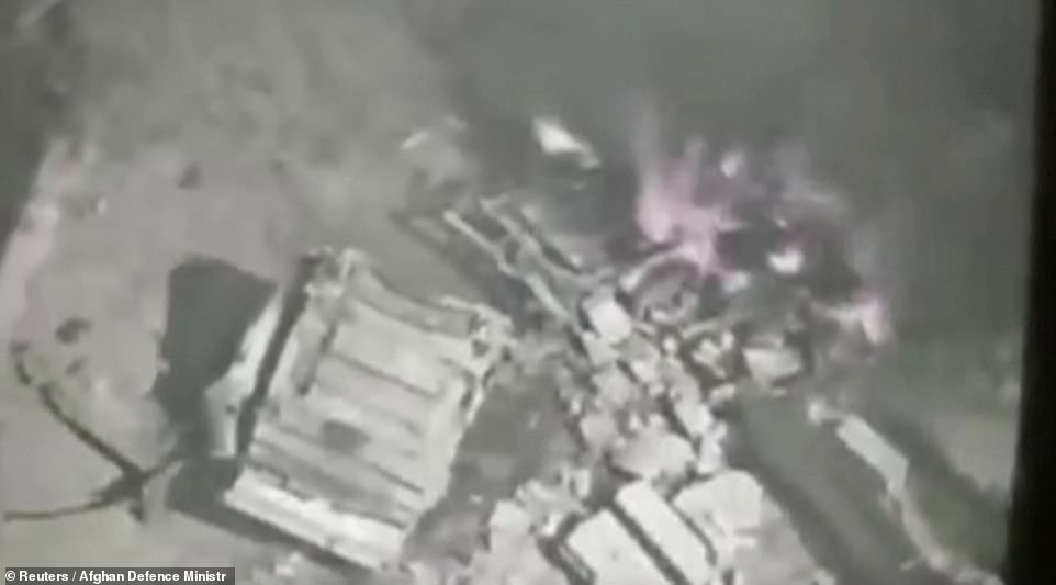 The flaming wreckage of a Taliban vehicle is seen in footage taken by the Afghan air force and posted online in an attempt to rally government forces that are otherwise being pushed back on all fronts