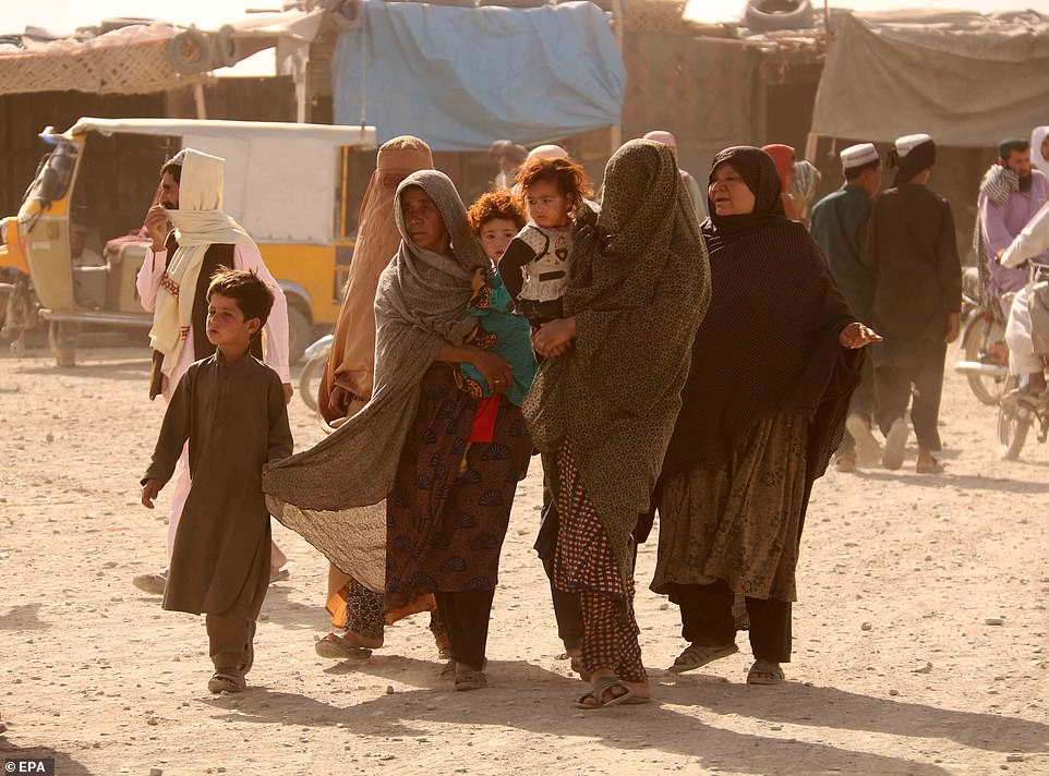 Women and their children are seen near the Spin Boldak border crossing between Pakistan and Afghanistan