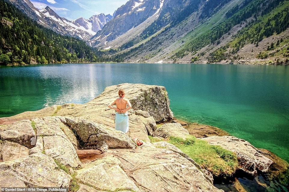 LAC DE GAUBE, PYRENEES ATLANTIQUES: This 'ethereal, turquoise lake' with seashores is backed by snowcapped peaks and has a big rock for diving. Co-ordinates: 42.8339, -0.1390