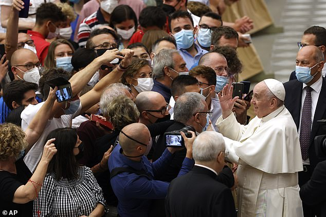 Pope Francis greets the faithful at the end of his weekly general audience in the Paul VI hall at the Vatican on Wednesday