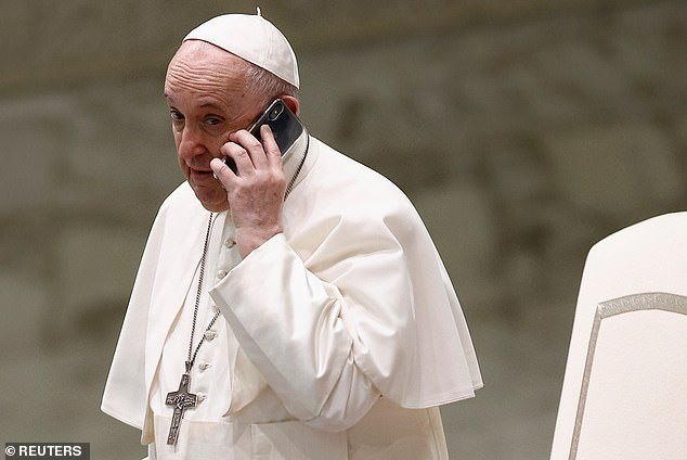 Pope Francis today interrupted his weekly audience with the public to take a phone call in a decidedly unusual break from protocol
