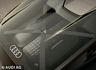 The car's boat tail rear houses a set of custom luggage under glass