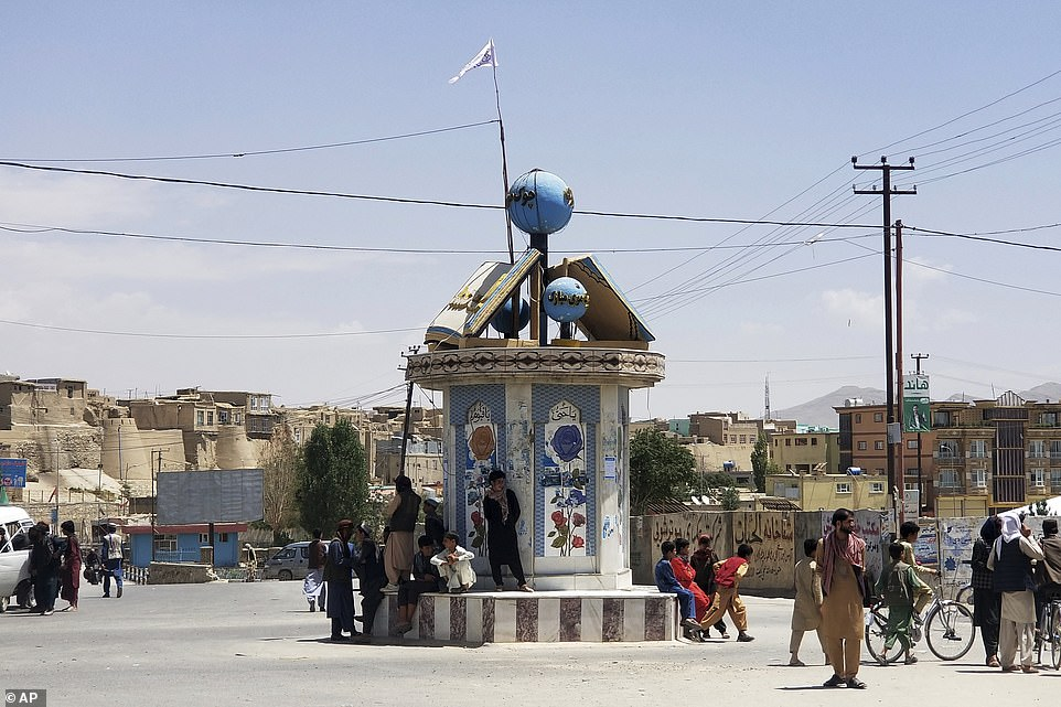 The Taliban flag flies over the main square in Ghazni, Afghanistan, signalling its capture by jihadist fighters