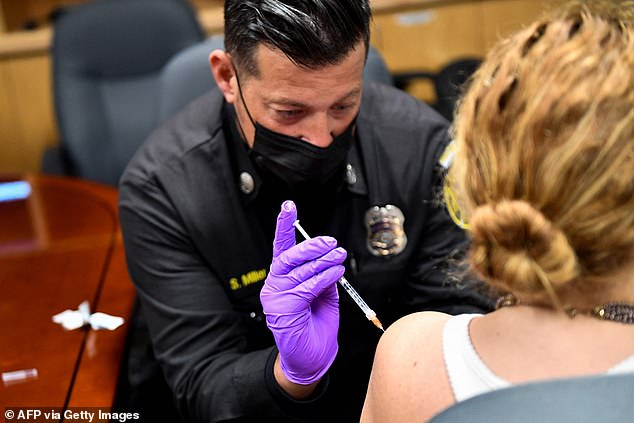 Misinformation about the COVID-19 vaccines has become rampant on social media, though platforms are pushing back against it, hoping to encourage Americans to get the shots. Pictured: A woman receives the COVID-19 vaccine in Culver City, California last week