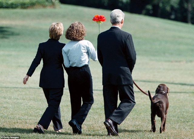 The original: Hillary, Chelsea, and Bill with their dog Buddy in 1999 amid the scandal