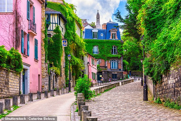 Skyscanner revealed that as a result of France's status changing on the traffic light system, week-by-week bookings from the UK to the country are up by 75 per cent. Pictured is Montmartre, Paris