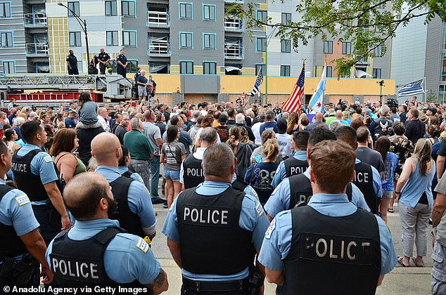 Two hundred cops turned out to honor French at a prayer vigil on Tuesday after being 'banned' from holding the procession