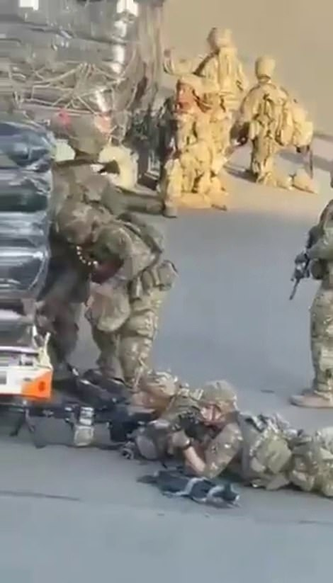 Soldiers fired warning shots in the air to prevent hundreds of civilians running onto the tarmac