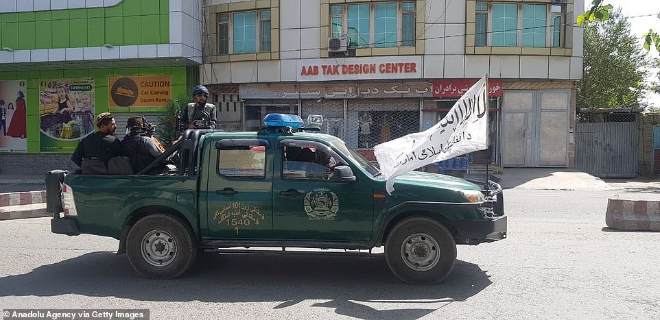 Taliban members patrol the streets of Afghan capital Kabul on August 16, 2021, as the Taliban takes control of Afghanistan after President Ashraf Ghani fled the country
