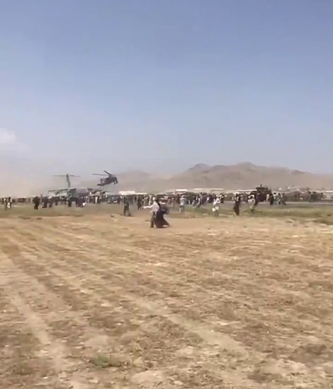 US military Appache helicopters were seen flying low over Kabul airport