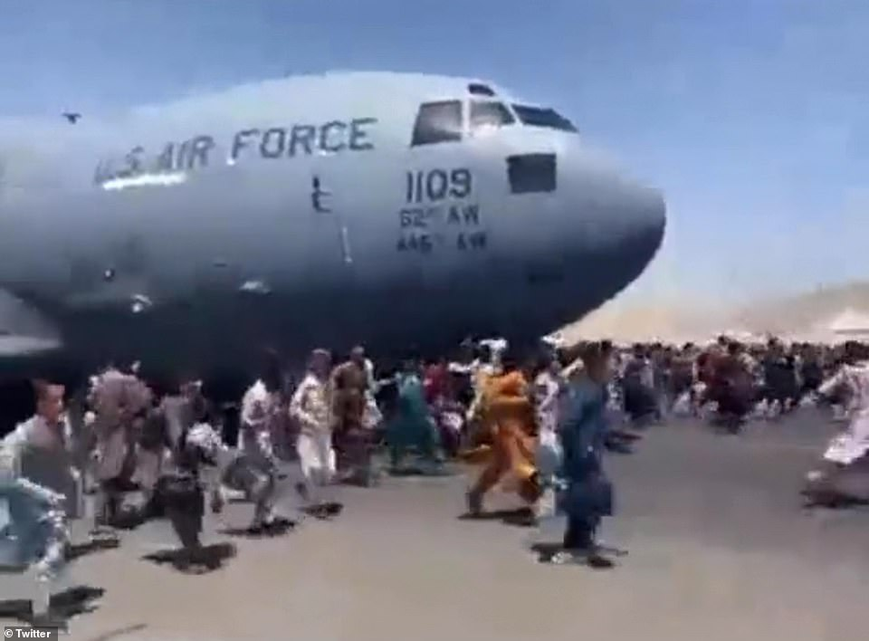 Footage from Hamad Karzai airport showed hundreds of people running alongside - and in front of - a US Air Force plane preparing to take off