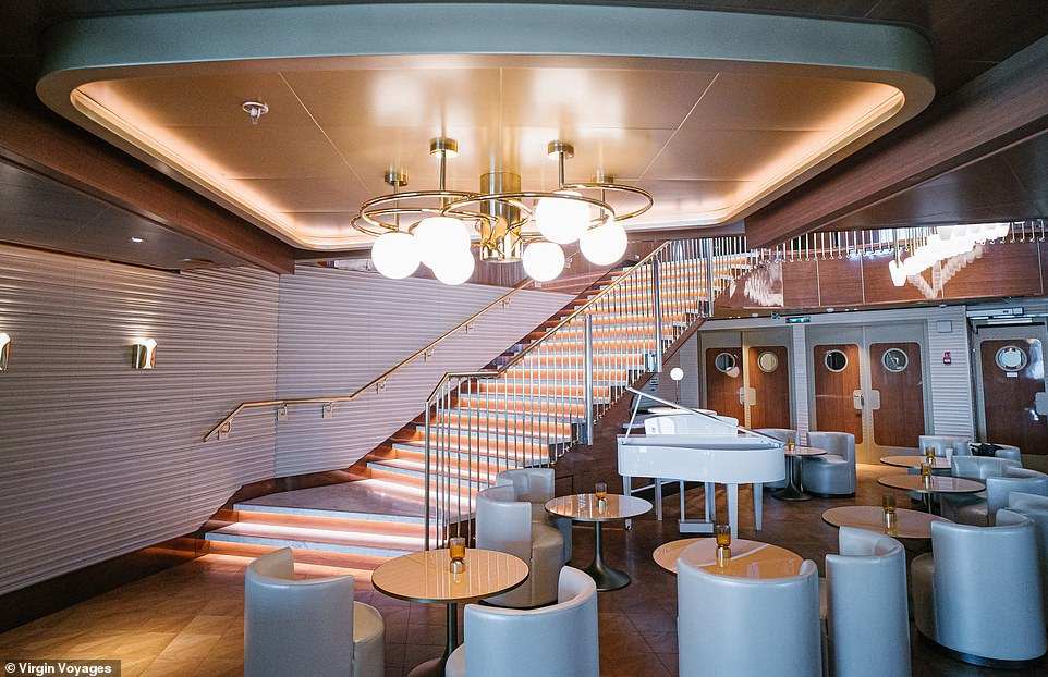 Every restaurant aboard the Scarlet Lady has its own decor, lighting, music and mood. Pictured isThe Wake restaurant