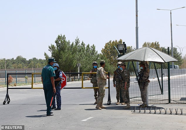 Border guards are seen at a checkpoint at the Uzbekistan-Afghanistan border in Ayritom, Uzbekistan, on Sunday