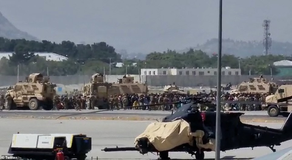 Senior US military officials said troops shot and killed two armed Afghans among those trying to get onto the jet while US citizens were evacuated in two separate incidents