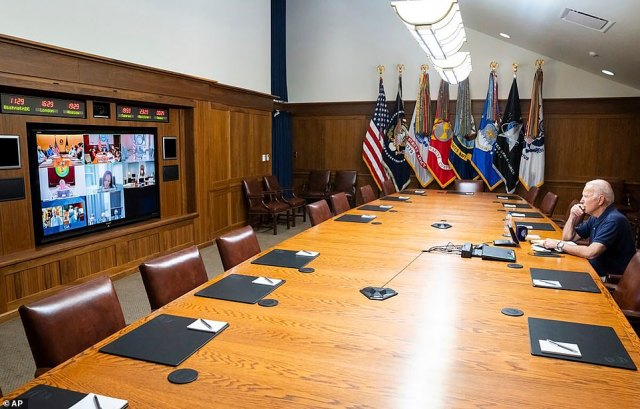 President Joe Biden meets virtually with national security advisers from Camp David where he was supposed to spend part of his August vacation